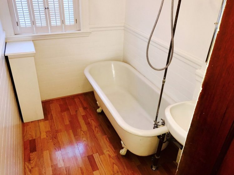 clawfoot tub in small bathroom