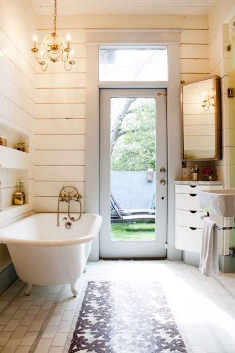 freestanding tub under window