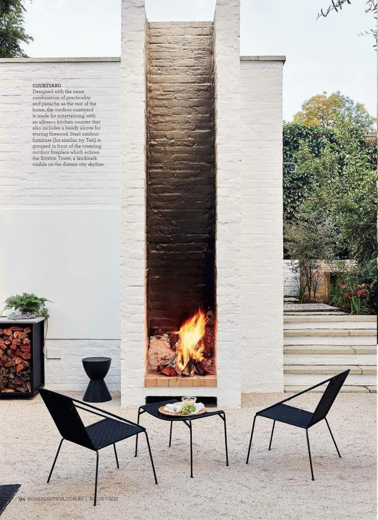 outdoor fireplace near pool