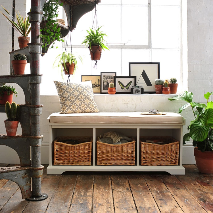 storage bench in front of bed