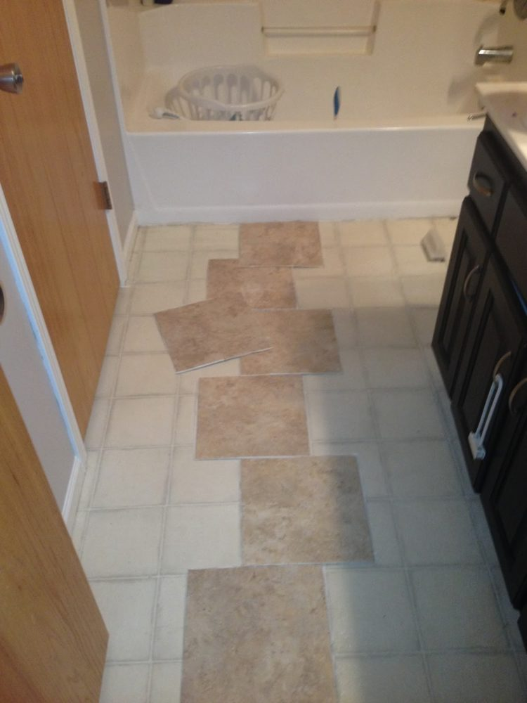 can peel and stick floor tile go on wall